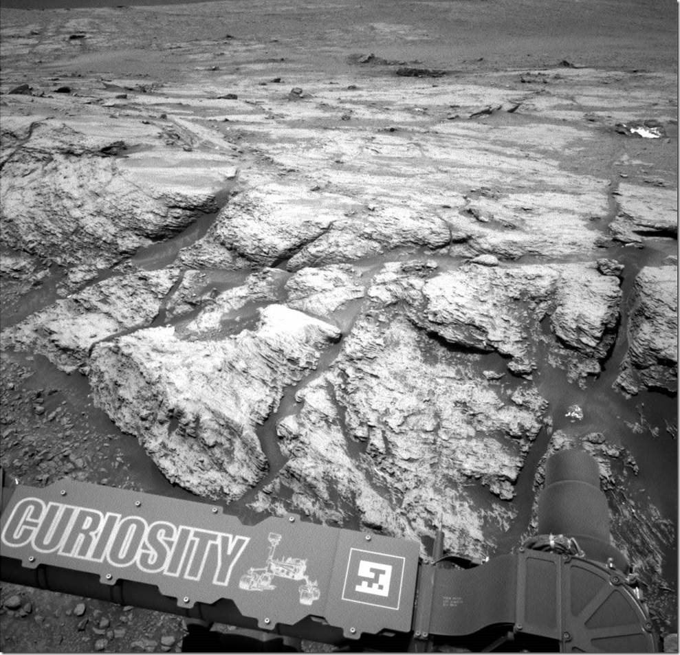 """This image was taken by the left Navcam on NASA's Curiosity Mars rover on June 18, 2019, the 2,440th Martian day, or sol, of the mission. It shows part of """"Teal Ridge,"""" which the rover has been studying within a region called the """"clay-bearing unit."""" Credits: NASA/JPL-Caltech"""